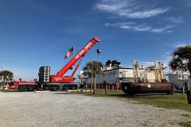 crane-parked-next-to-a-cargo-boat-in-a-south-carolina-harbor